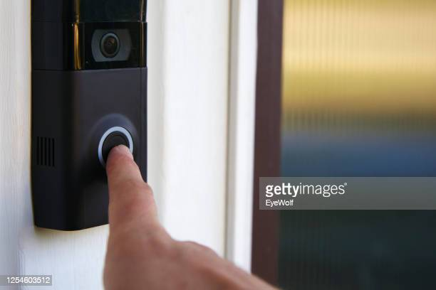 close up pov shot of a person ringing a smart doorbell - bell stock pictures, royalty-free photos & images