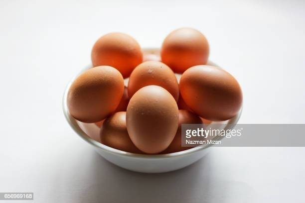 A  close up shot of eggs on white background. A food concept.