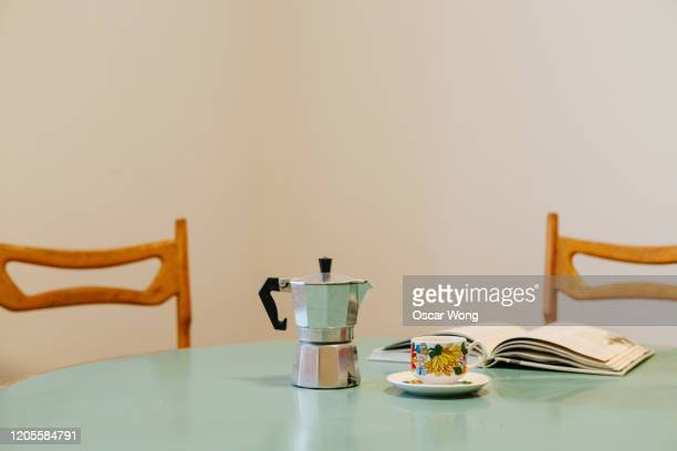 close up shot of espresso maker on a dining table - ダイニングテーブル ストックフォトと画像
