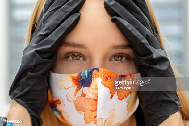 close up shot of face with mask on - stress coronavirus stock pictures, royalty-free photos & images