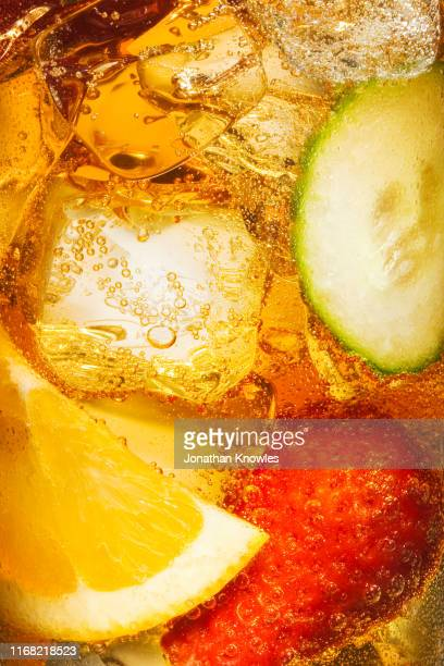 close up shot of fruit in liquid - halved stock pictures, royalty-free photos & images