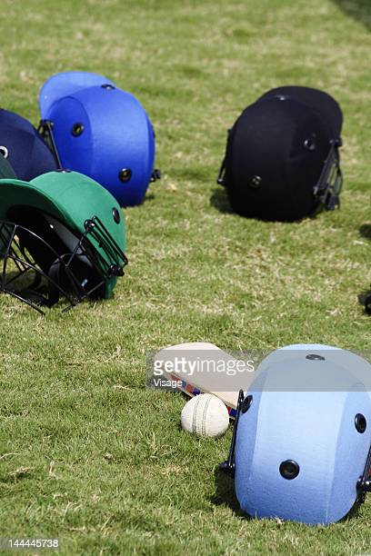 Close up shot of helmets and a ball