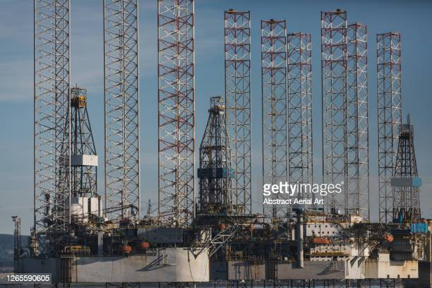 close up shot of oil platforms, cromarty firth, scotland, united kingdom - economy stock pictures, royalty-free photos & images
