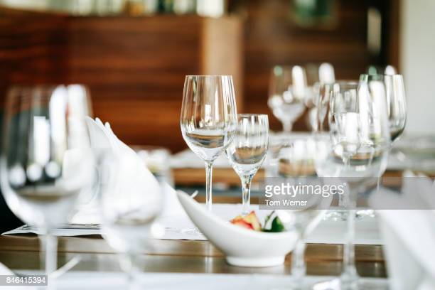 close up shot of restaurant table setup - glas serviesgoed stockfoto's en -beelden