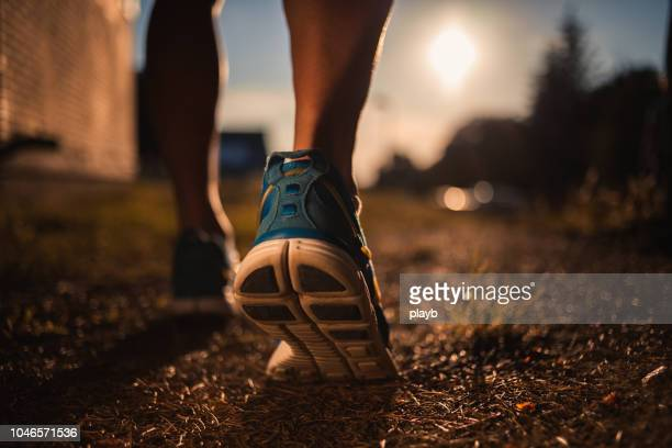 close up shot of runner's shoes - running stock pictures, royalty-free photos & images