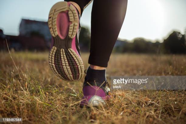 close up shot of runner's shoes - purple shoe stock pictures, royalty-free photos & images