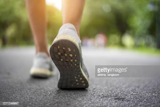 close up shot of runner's shoes - schuhwerk stock-fotos und bilder