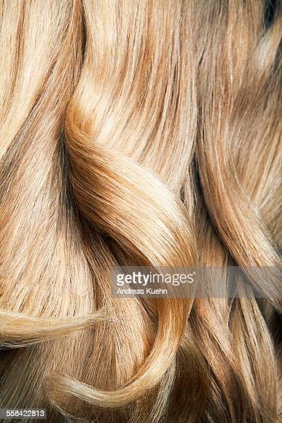 Close up shot of wavy, blond hair.
