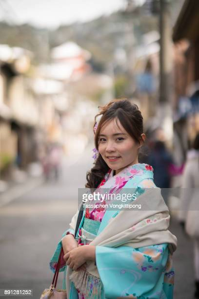 close up shot of young woman in kimono japanese traditional clothes