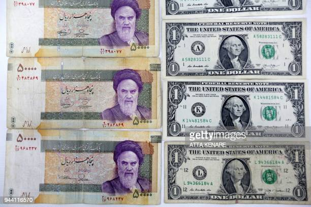 A close up shot shows Iran's various Rial banknotes bearing a portrait of Iran's late founder of Islamic Republic Ayatollah Ruhollah Khomeini next to...