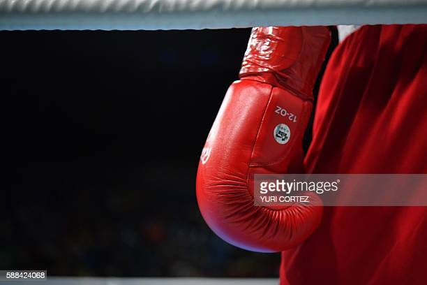 A close up shot shows Morocco's Mohammed Rabii's boxing glove as he fights Kenya's Rayton Nduku Okwiri during the Men's Welter match at the Rio 2016...