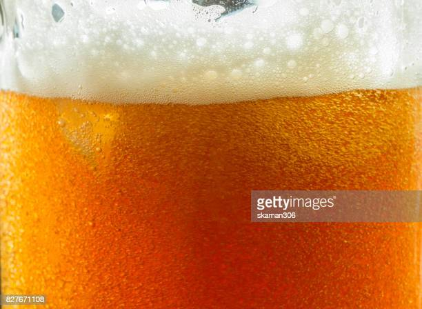 close up shot with foam beer of german dark beer inside beer mug - ale stock pictures, royalty-free photos & images