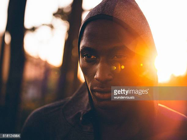 Close up shot with lens flare of determined african-american ath