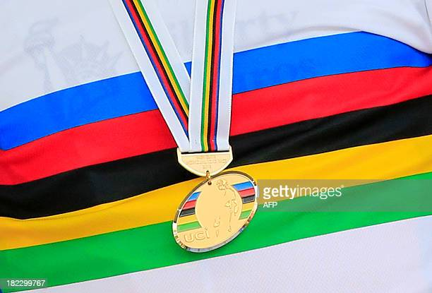 A close up shows the gold medal of Portugal's Alberto Rui Costa on the podium of the elite men's road race UCI World Championship on September 29...
