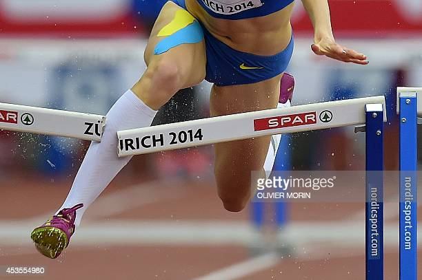 A close up shows Ukraine's Hanna Ryzhykova leg breaking a hurdle before crashing out as she competes in the women's 400m hurdles heats during the...