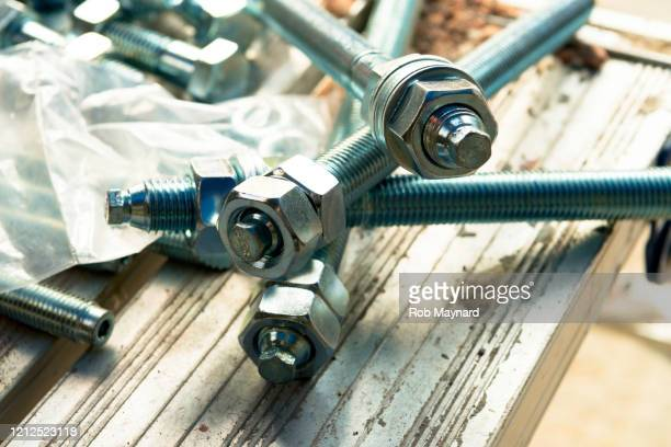 close up silver of bolt and nut - crash site stock pictures, royalty-free photos & images