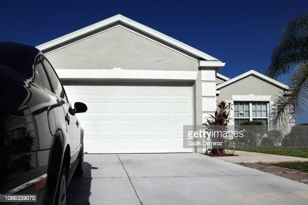 close up single family house exterior over blue sky - florida landscaping stock pictures, royalty-free photos & images