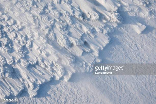 close up snow patterns caused by wind - extreme weather stock photos and pictures