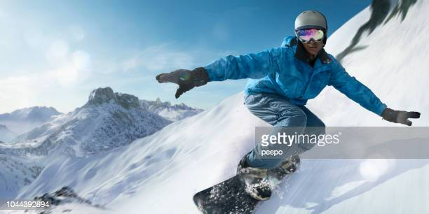 close up snowboarder moving at high speed down mountain slope - winter sport stock pictures, royalty-free photos & images