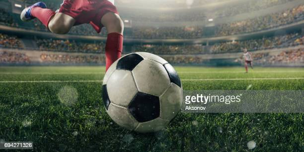 close up soccer kids player with ball - kicking stock pictures, royalty-free photos & images