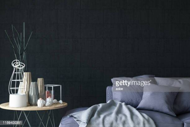close up sofa with decors and black wall - home showcase interior stock pictures, royalty-free photos & images