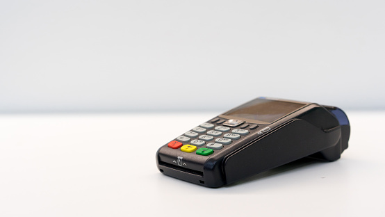 close up soft focus credit card reader  machine at white background table for  business financial about contactless payment concept 1141511228