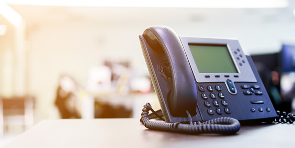 close up soft focus on telephone devices at office desk for customer service support concept 1032472578