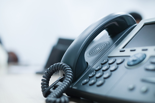 close up soft focus on telephone devices at office desk for customer service support concept 992782254