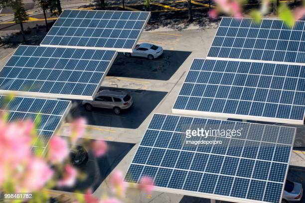 close up solar panels placed on a city public parking lot - solar mirror stock pictures, royalty-free photos & images