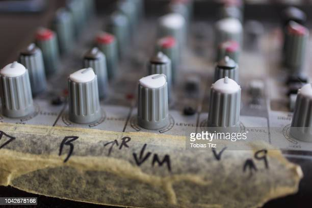 close up sound mixer dials with taped markings - gol di pareggio foto e immagini stock