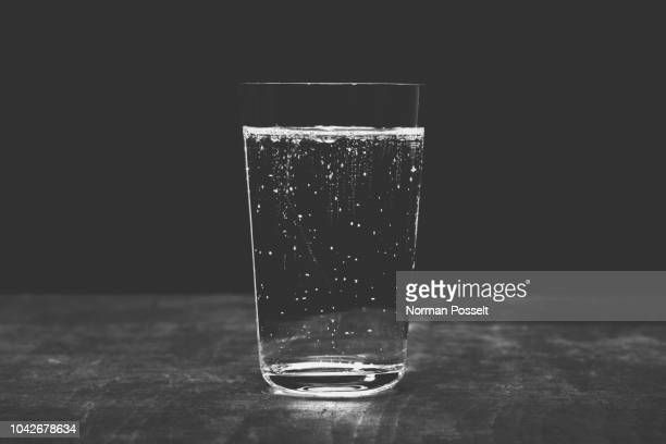 Close up sparkling water in glass