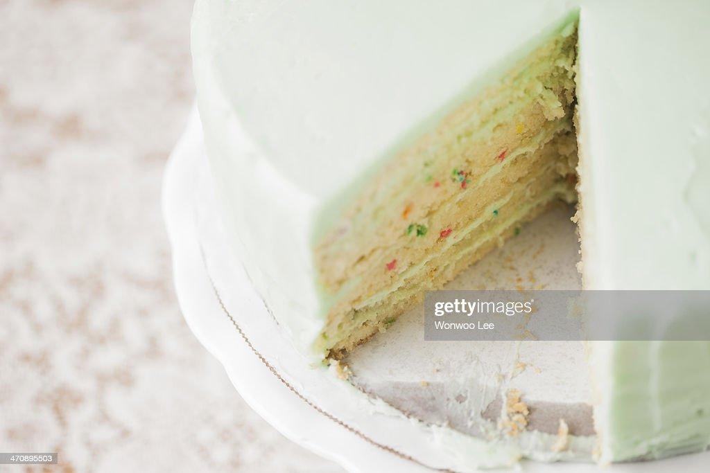 Close up still life of sliced celebration cake : Stock Photo