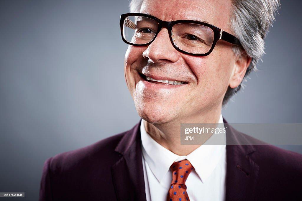 Close up studio portrait of smiling mature businessman : Stock Photo