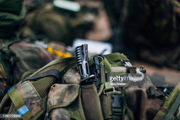 close up view of a bayonet handle in military load carrying vest - training grounds stock pictures, royalty-free photos & images