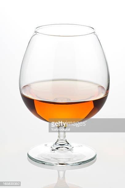 Close up view of a cognac glass or snifter half full
