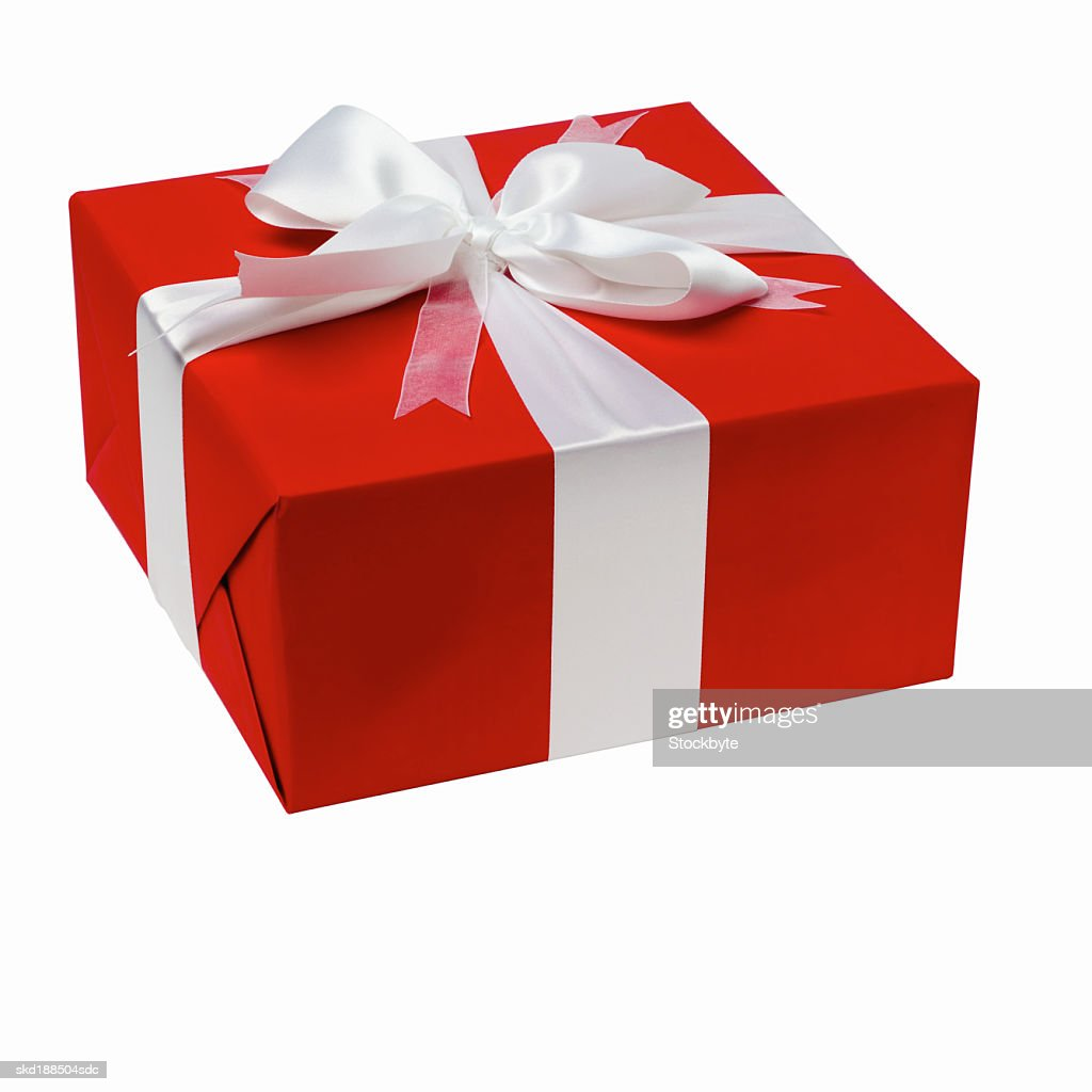 Close up view of a gift with a ribbon : Stock Photo