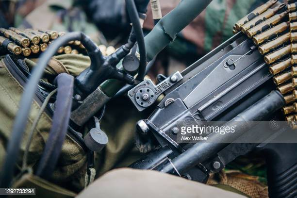 close up view of a light machine gun with details of sight and radio. - gunman stock pictures, royalty-free photos & images