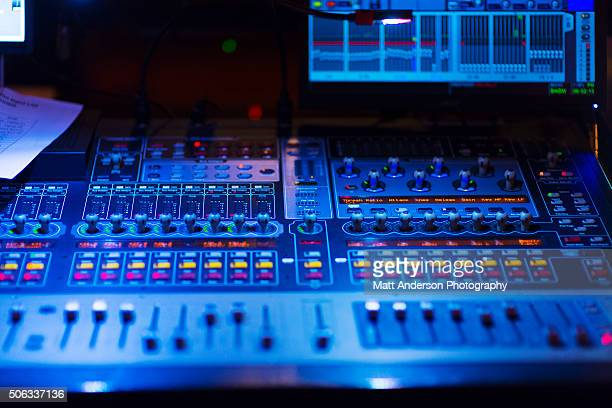 Close up view of a mixing board at a concert venue.