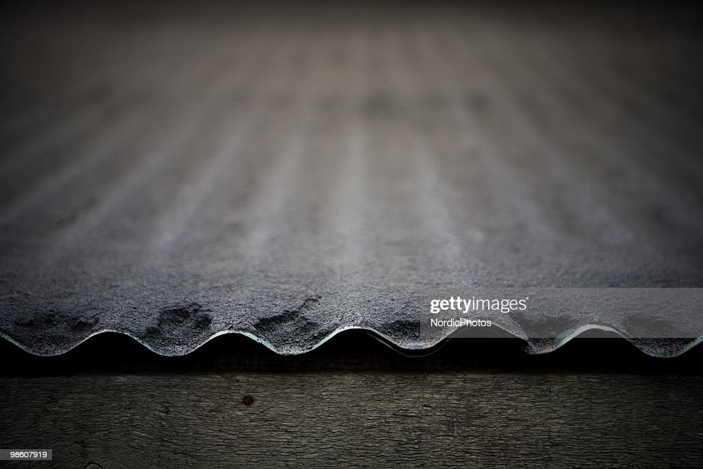 A close up view of a roof covered by a thick layer of ash from the Eyjafjallajokull volcano covers the ground, on April 21, 2010 in Skogar, Iceland. The ash is destroying pasture and polluting water supplies which is poisoning animals and is causing farmers severe financial difficulties.