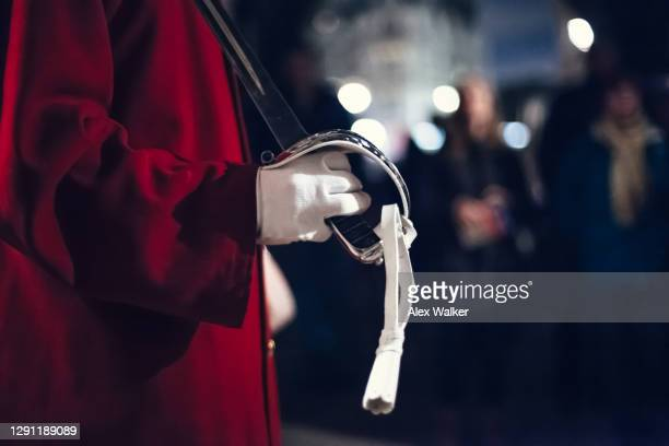 close up view of a soldier holding a polished sword - british royal family stock pictures, royalty-free photos & images