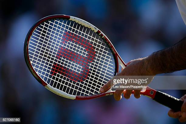 Close up view of a tennis player holding a Wilson tennis racket during the 2006 Wimbledon Tennis Championships at the All England Lawn Tennis Club in...