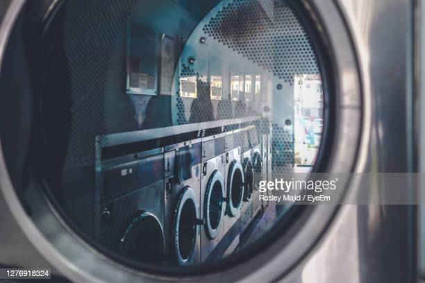close up view of a washing machine at the laundry - laundry stock pictures, royalty-free photos & images