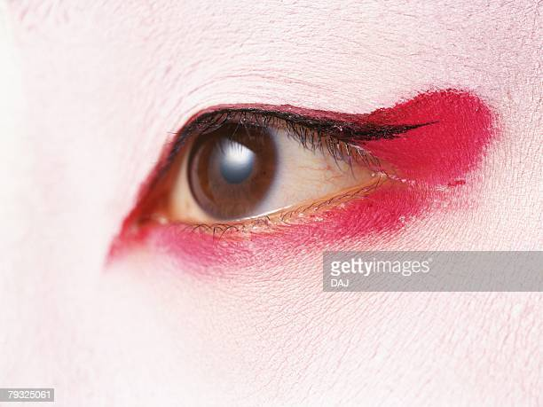 Close up view of an eye of the Kabuki actor acting as female