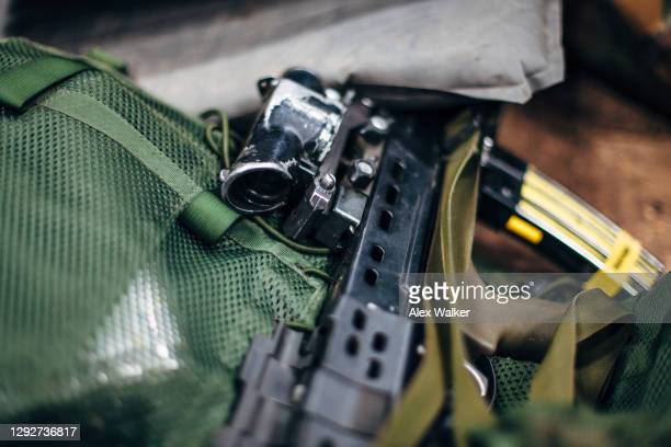 close up view of an l85a2 assault rifle with yellow training magazine - training grounds stock pictures, royalty-free photos & images