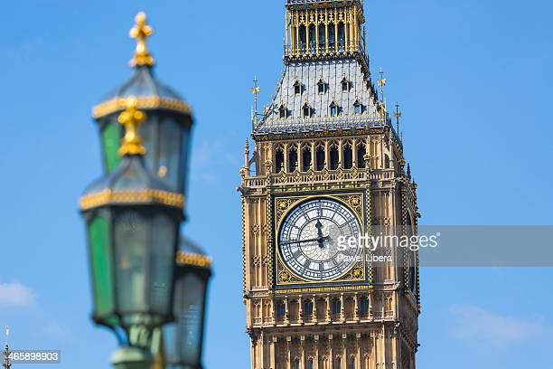 Close up view of Big Ben Clock Tower and a lamp on Westminster Bridge