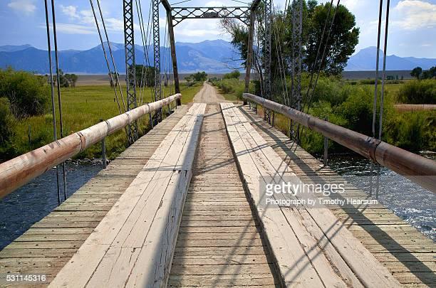 close up view of bridge across a river - timothy hearsum stock-fotos und bilder