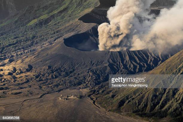 close up view of Bromo volcano with temple building on ground