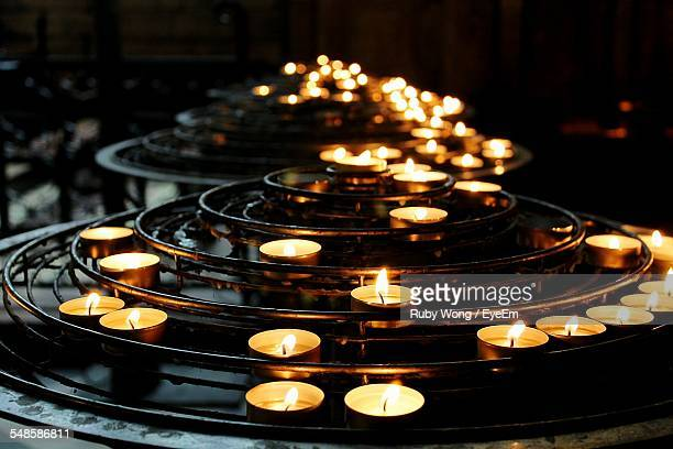 Close Up View Of Candles In Place Of Worship