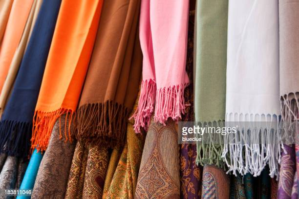 Close up view of colorful pashmina shawls hanging in 2 rows