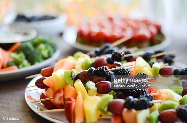 Close Up View Of Fresh Fruit On Skewers